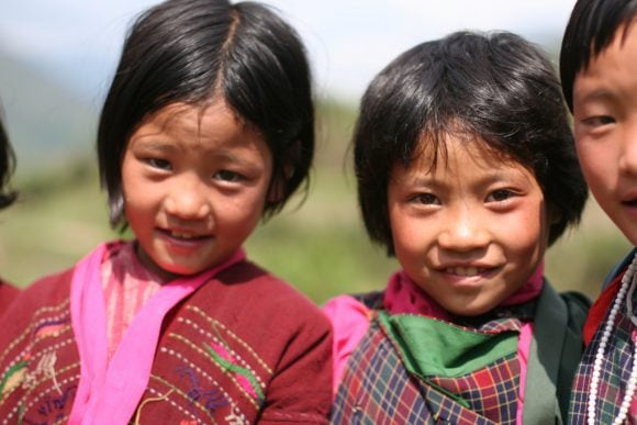 happy bhutan kids (Wikimedia Commons)