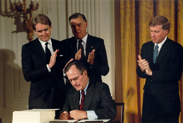 President George H.W Bush signed the Clean Air Act Amendment