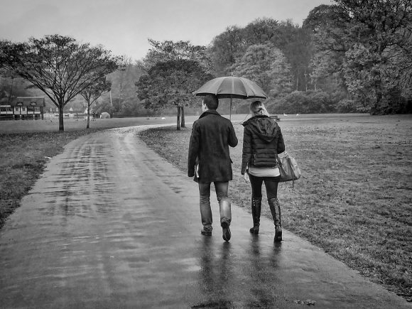 walking in the rain (Wikimedia Commons)