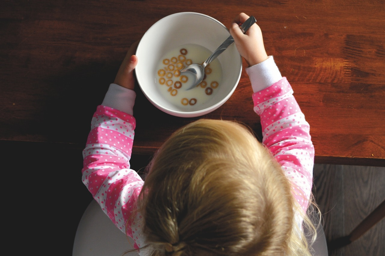 a girl finishing her cereal