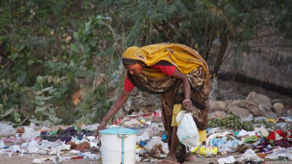 Woman Picking Trash