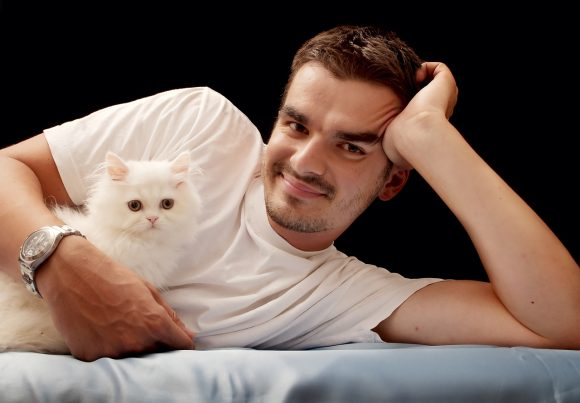cat owners cuddling with a cat