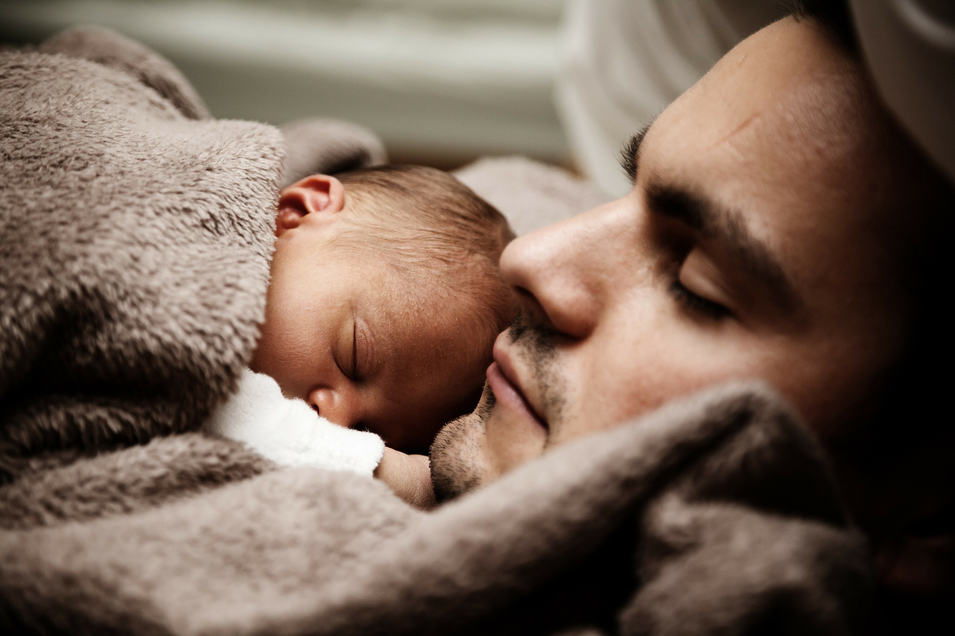 baby sleeping with dad
