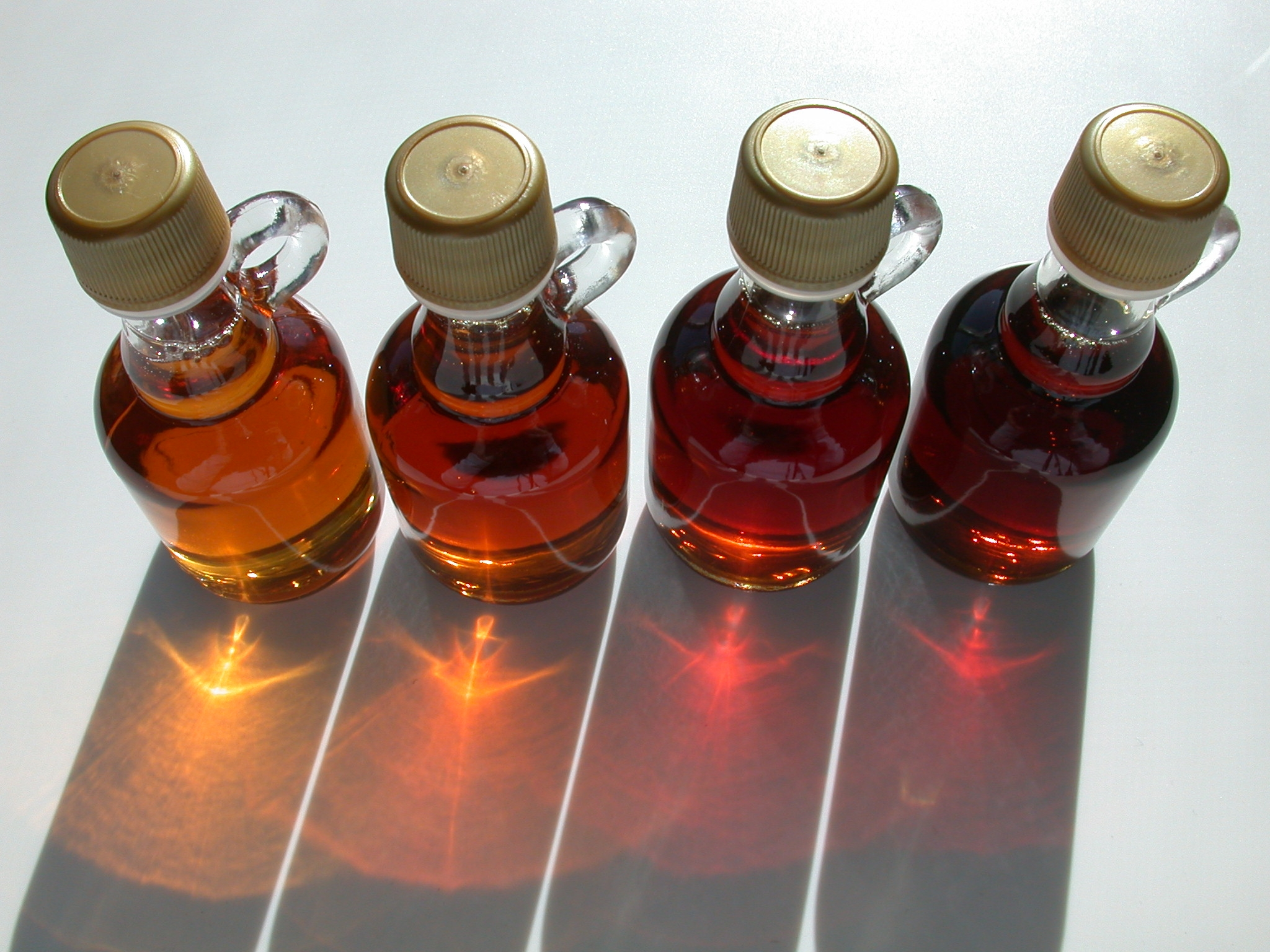 different grades of maple syrup. photo by Dvortygirl Wikimedia Commons