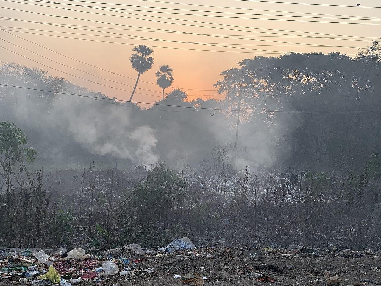 A burning roadside garbage dump near Mumbai