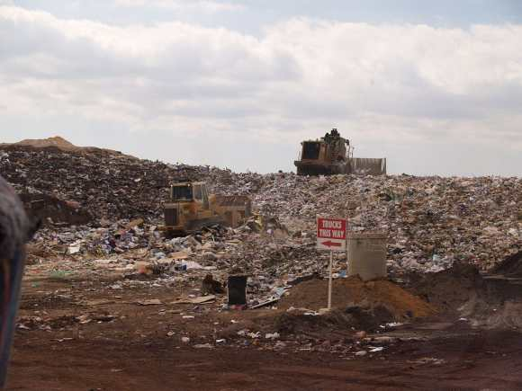 compost putting landfill